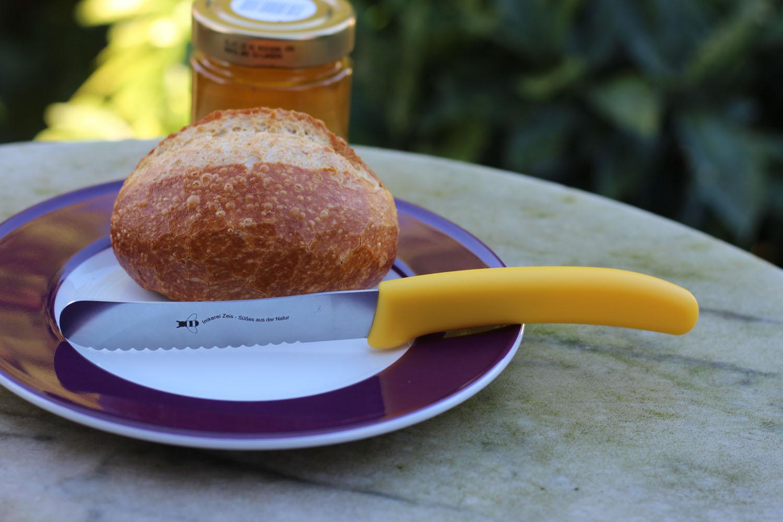 Brötchenmesser mit Werbelogo und gelbem Griff
